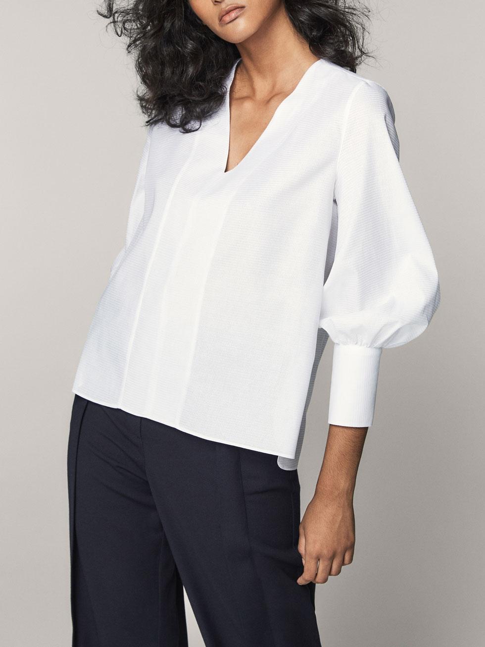 FOTO 13: Modelo blusa blanca